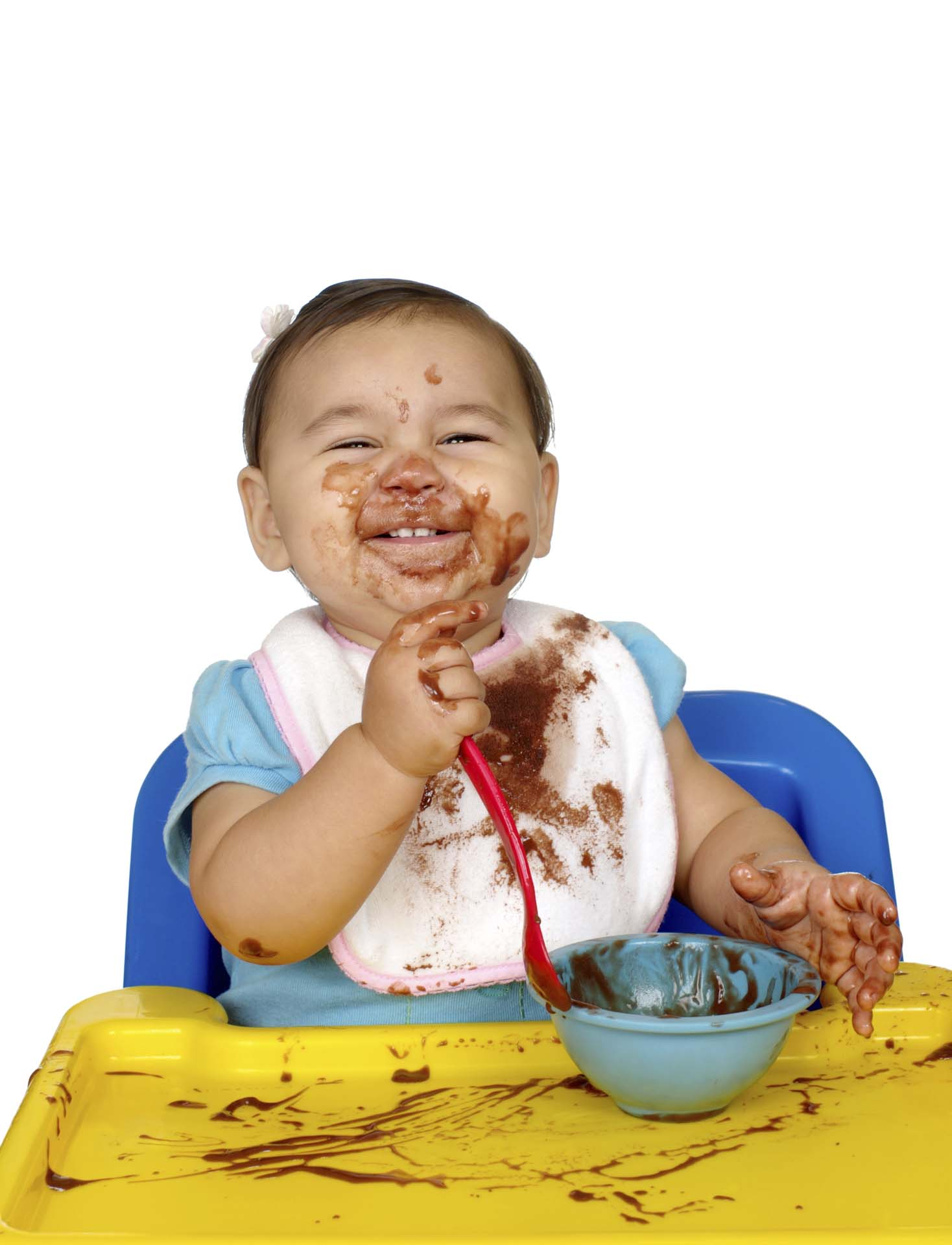 baby girl eating chocolate pudding, messy face