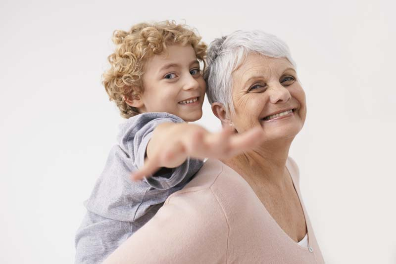 Shot of a grandmother giving her grandson a piggback